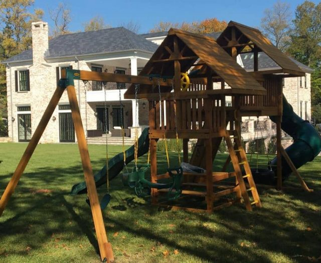 Fantasy Jungle Gym with Wood Roof, Swings, and Picnic Table