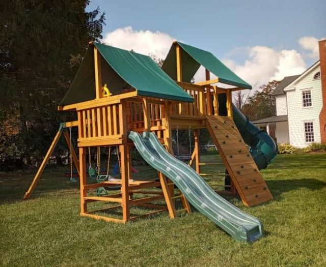 Fantasy Playground with Wave Slide, Rock Wall, and Telescope