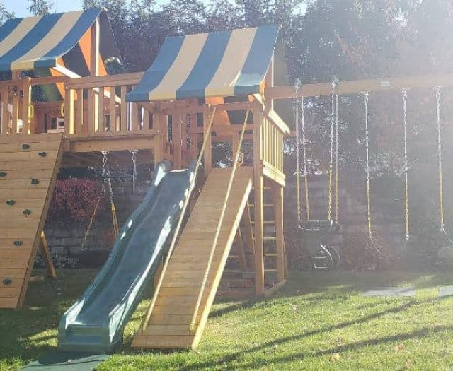 Fantasy Swing Set with Horse Glider, Rock Wall, and Gang Plank