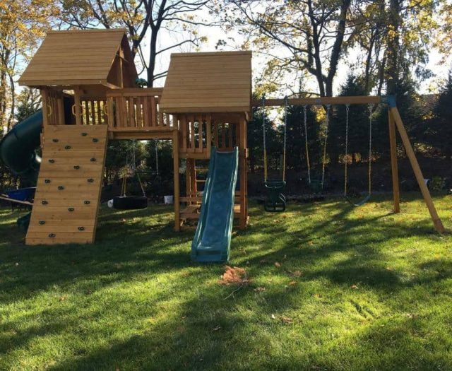 Fantasy Swing Set with Wood Roof, Spiral Slide, and Swings