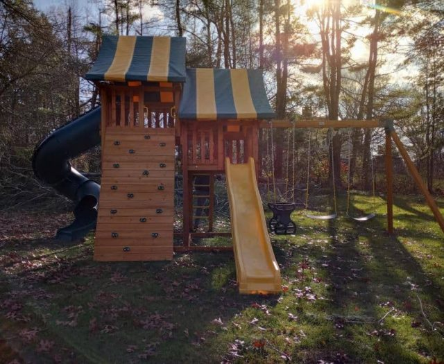Sky Swing Set with Yellow Wave Slide, Rock Wall, and Horse Glider Swing