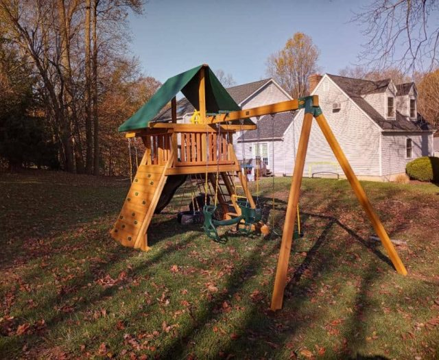 Supreme Swing Set with Horse Glider, Ships Wheel, and Rock Wall