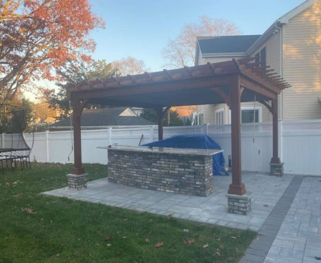 Traditional Pergola Stained Wood on Stone
