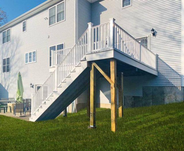 two story composite deck with white vinyl railings