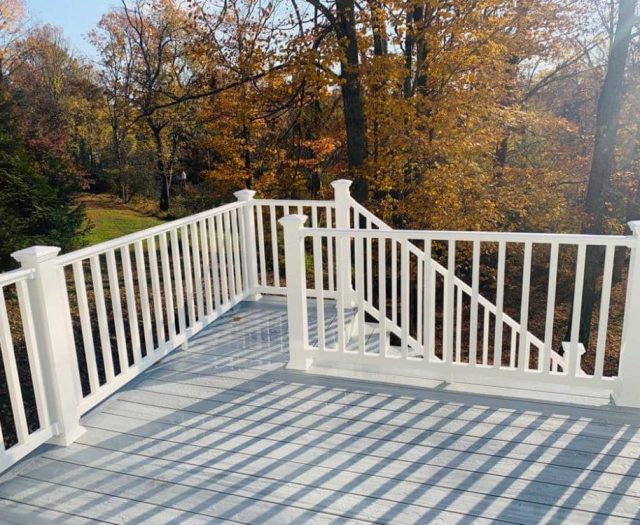 westminster gray composite deck with white vinyl railings