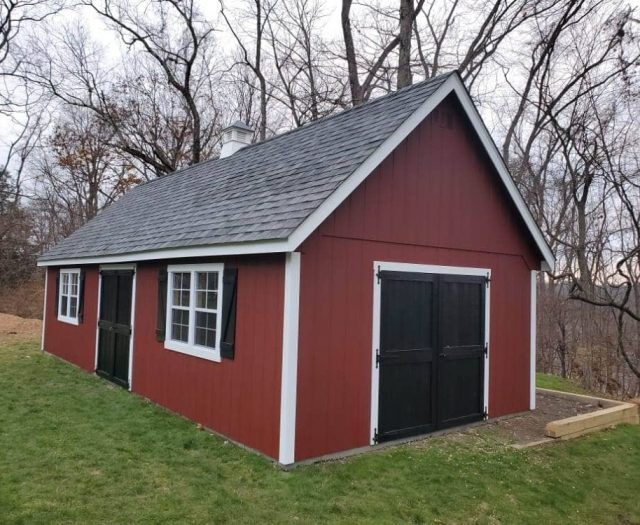A- Frame Backyard Shed with Red T-111 Siding, Black Double Doors and Barn Shutters