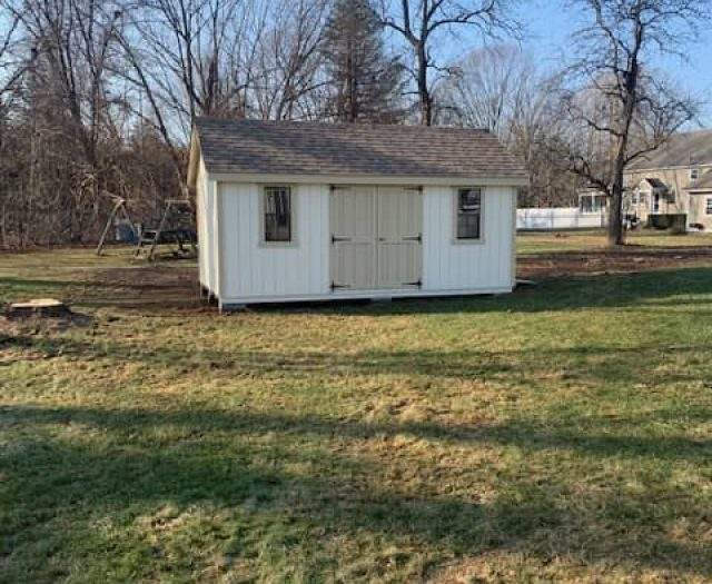 A- Frame Backyard Shed with White T-111 Siding, Tan Double Doors and Tan Trim