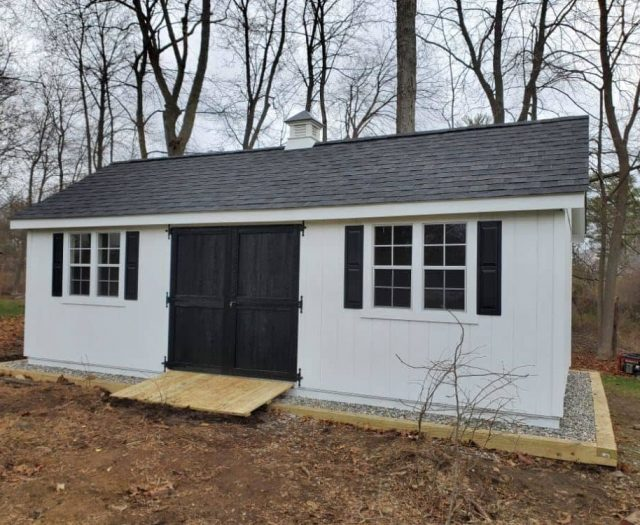 A- Frame Shed with White T-111 Siding, Black Double Doors, PT Ramp, and Windows