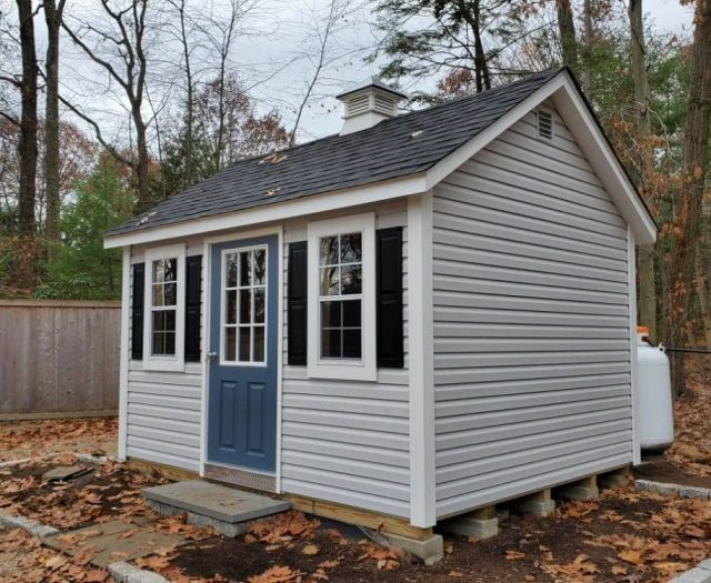 A- Frame Shed with White Vinyl, Concrete Step, and Windows