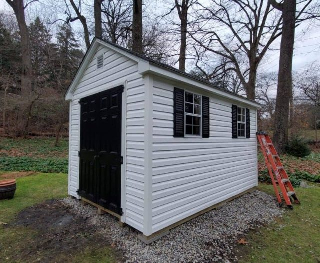 A- Frame Shed with White Vinyl Siding, Black Double Doors, and Black Shutters