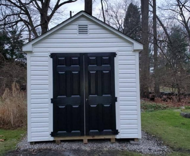 A- Frame Shed with White Vinyl Siding, Black Double Doors, and Vent