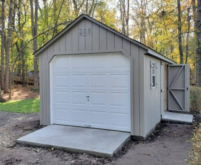 A- Frame Singe Car Garage with Gray T-111 Siding, White Garage Door and Gray Double Doors