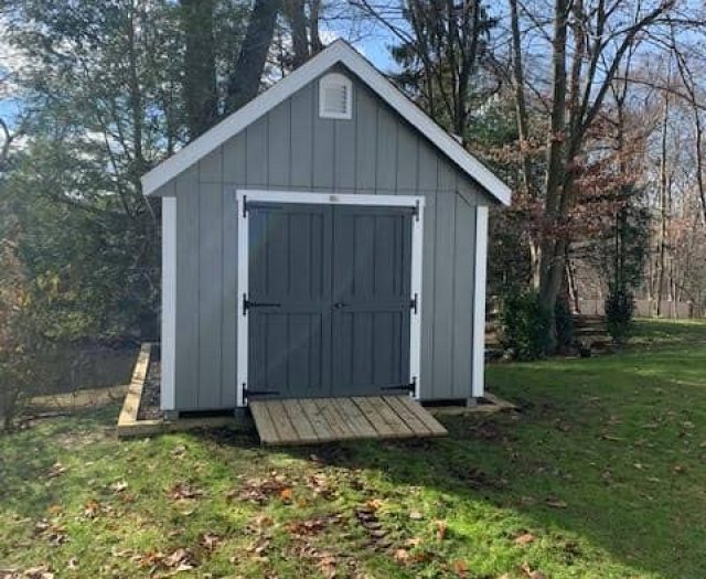 A- Frame Storage Shed with Blue T-111 Siding, White Trim and Dark Grey Double Door