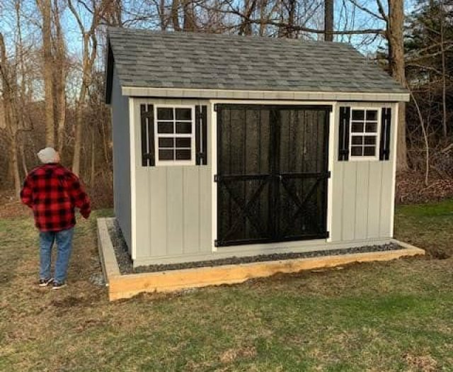 A- Frame Storage Shed with Gray T-111 Siding, Black Double Door, and White Trim