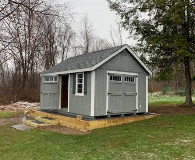 A- Frame Storage Shed with Gray T-111 Siding, White Trim, and Windows