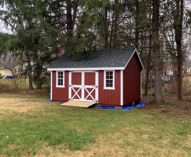 A-Frame Storage Shed with Red T-111 Siding, White Trim, and Barn Trim Double Doors