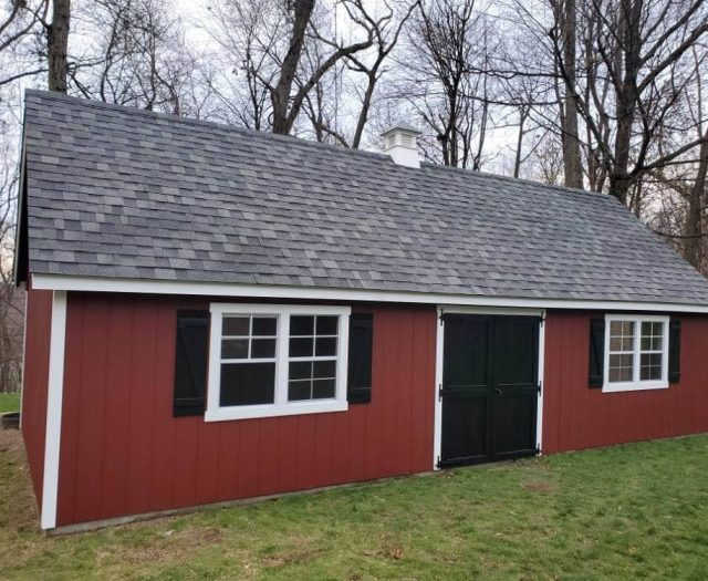 A- Frame Storage Shed with Red T-111 Siding, White Trim, and Cupola