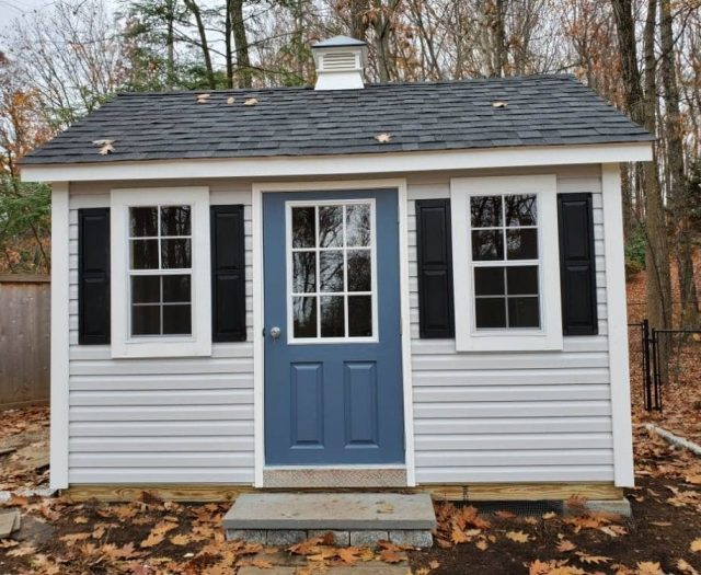 A- Frame Storage Shed with White Vinyl Siding, Blue Door, and Cupola