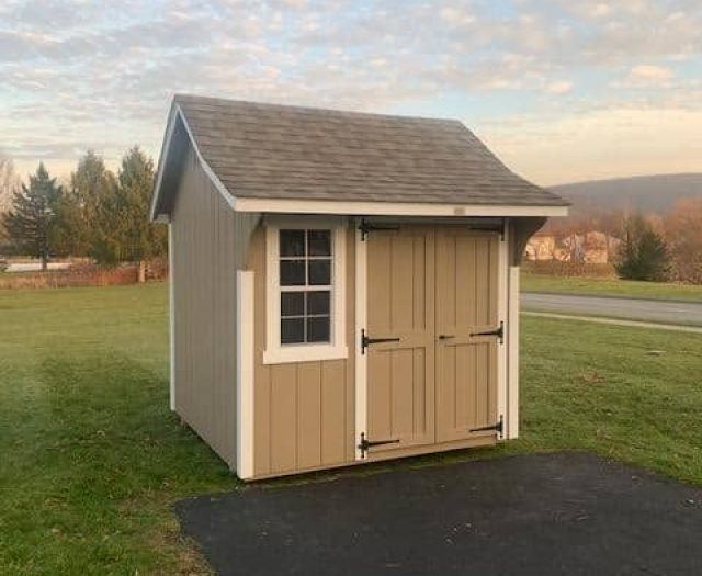 Cape Storage Shed with Beige T-111 Siding, White Trim, and Window