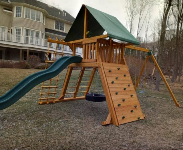 Extreme Swing Set with Tire Swing, Rock Wall, and Scoop Slide