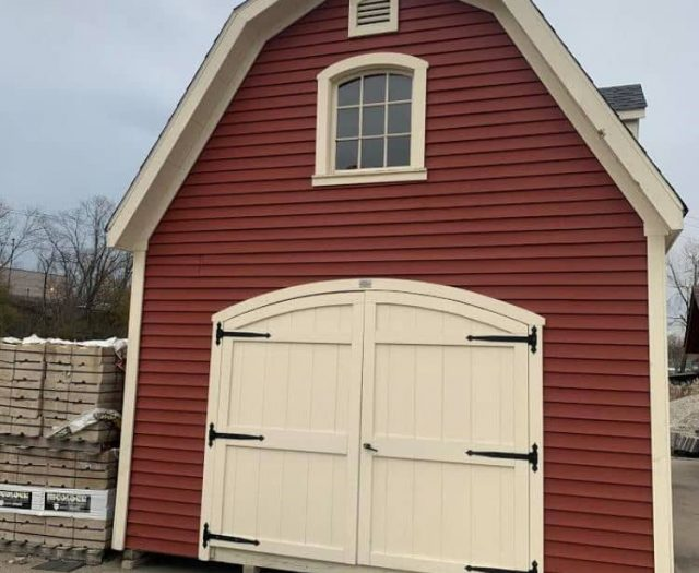Liberty 2 Story Shed with Red Vinyl Siding, Wide Double Garage Doors, and Hatch Door