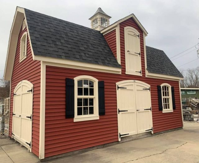 Liberty Two Story Shed with Red Vinyl Siding, Cream Trim, and Cupola