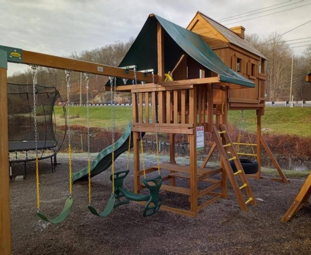 On Site- Sky Tree House Swing Set Display with Horse Glider, Picnic Table, and Tire Swing