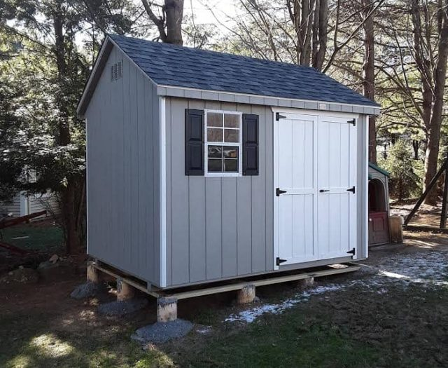 A-Frame Backyard Shed with Blueish Gray T-111 Siding, White Double Doors, and Black Shutters