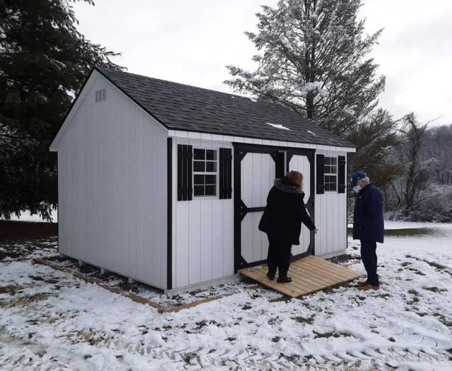 A-Frame Backyard Shed with White- T-111 Siding, Black Door Trim, and Black Shutters