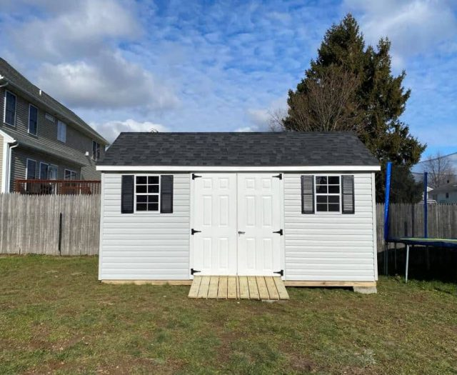 A- Frame Backyard Shed with White Vinyl Siding, Windows and Shingled Roof