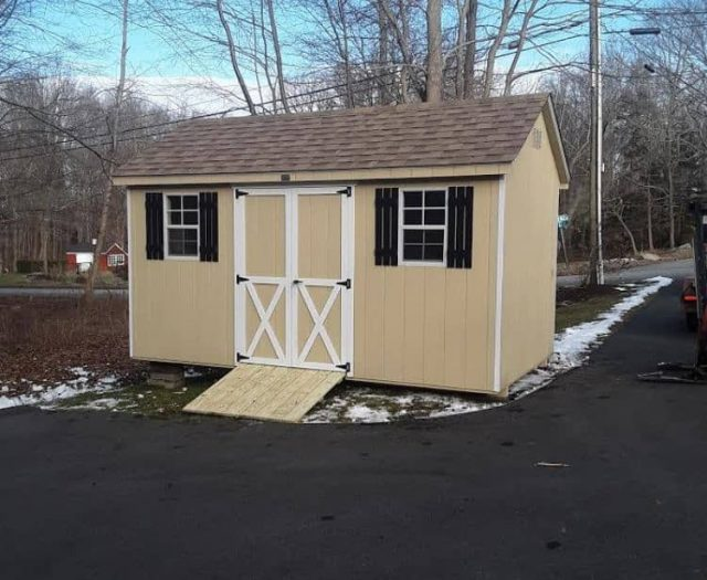 A-Frame Backyard Shed with Yellow T-111 Siding, White Trim, and Black Shutters