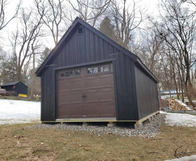A-Frame Garage with Black T-111 Siding and Brown Door