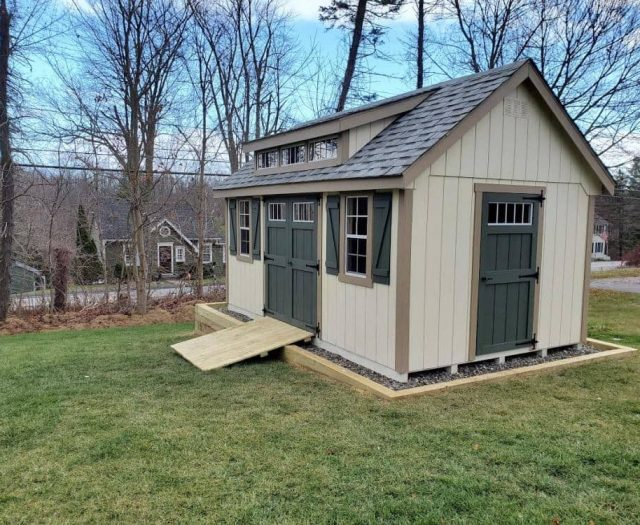 A-Frame Storage Shed with Beige T-111 Siding, Green Doors, and Tan Siding
