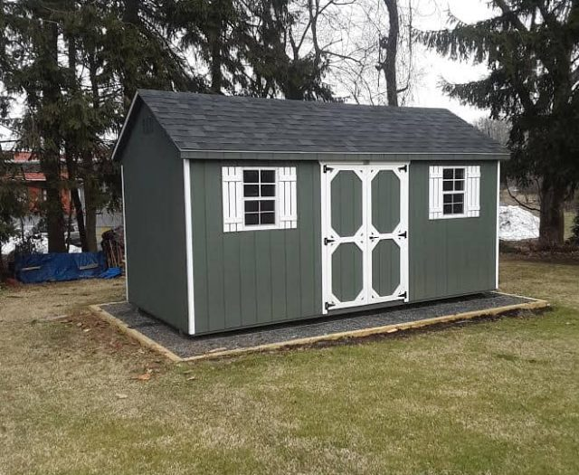 A- Frame Storage Shed with Green T-111 Siding, White Trim, and White Shutters