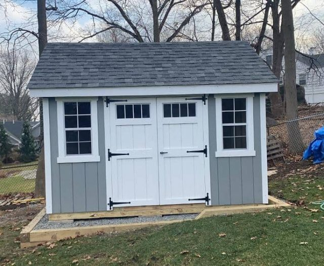 A-Frame Storage Shed with Greenish T-111 Siding, White Double Doors, and Door Windows