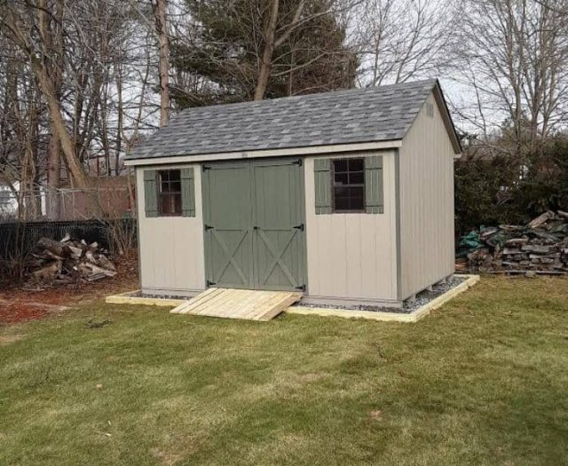 A-Frame Storage Shed with Tan T-111 Siding, Olive Doors, and PT Ramp