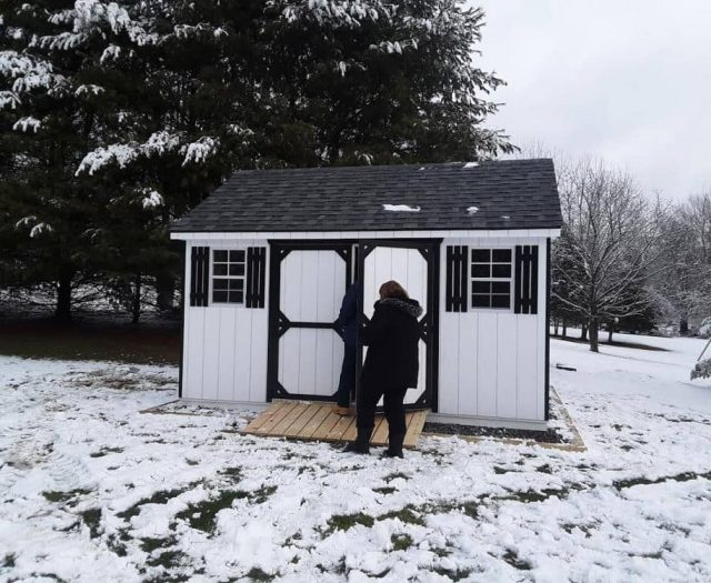 A-Frame Storage Shed with White T-111 Siding, Black Trim, and PT Ramp