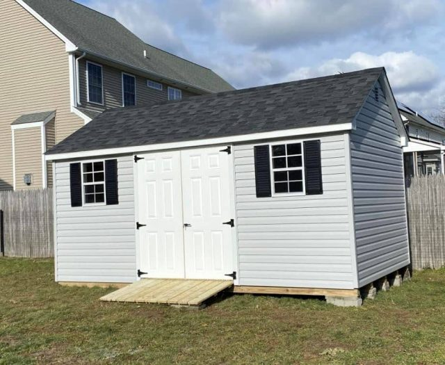 A- Frame Storage Shed with White Vinyl Siding, Black Shutters and Double Door