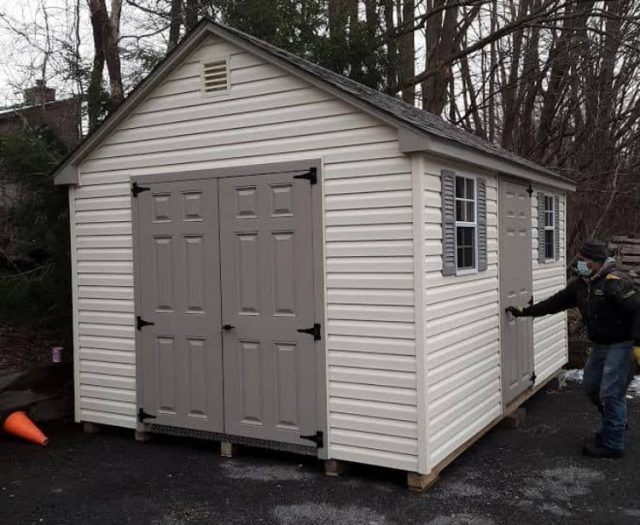 A-Frame Storage Shed with White Vinyl Siding, Gray Side Doors, and Grey Shutters