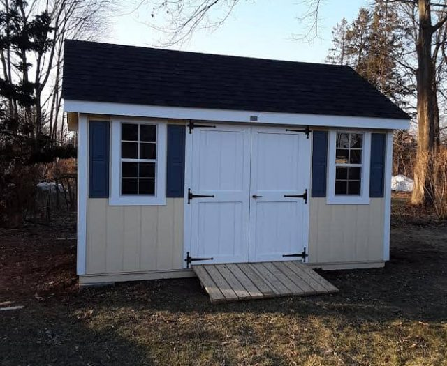 A-Frame Storage Shed with Yellow T-111 Siding, White Trim and Blue Shutters