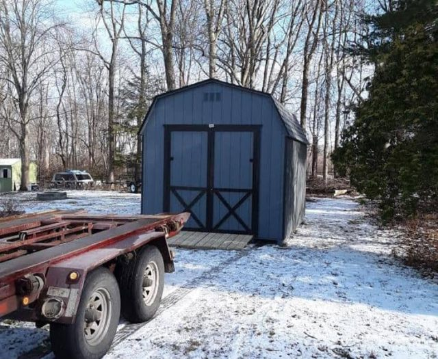Barn Shed with Blue T-111 Siding, Black Trim, and PT Ramp