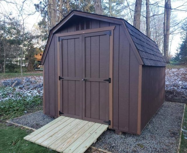 Barn Storage Shed with Bark Brown T-111 Siding, Light Brown Trim, and PT Ramp