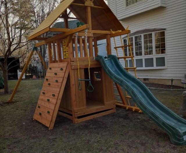 Dream Swing Set with Wave Slide, Rock Wall, and Wooden Roof