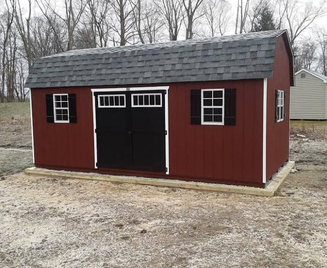 Dutch Barn Backyard Shed with Red T-111 Siding, Door Windows, and Black Shutters