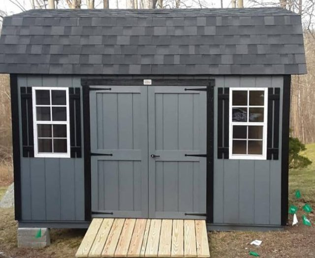 Dutch Barn Storage Shed with Gray T-111 Siding, Black Trim, and PT Ramp