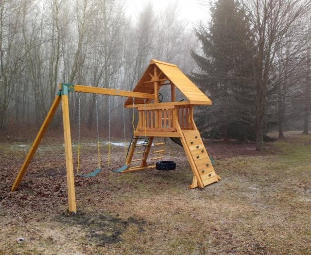 Supremescape Swing Set with Rock Wall, Tire Swing, and Wooden Roof