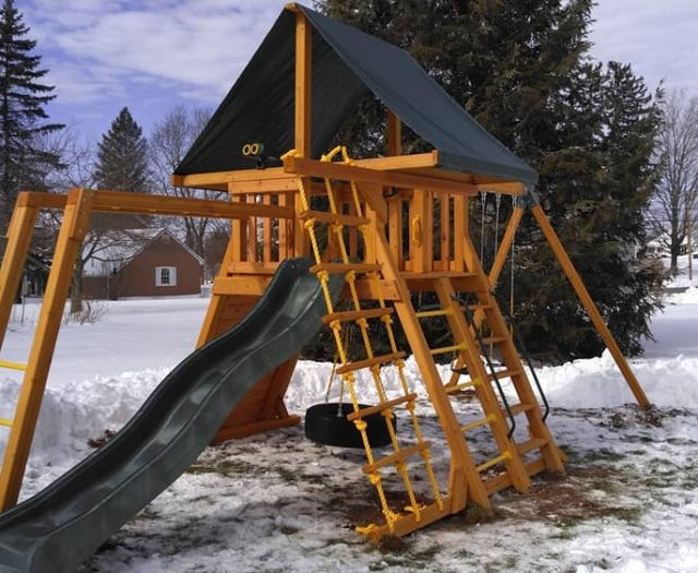 Supreme Jungle Gym with Wave Slide, Monkey Bars, and Winter Install