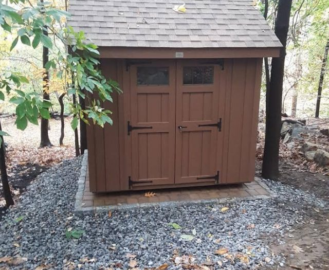 A-Frame Backyard Shed with Brown T-111 Siding, Brown Trim, and Brown Double Doors