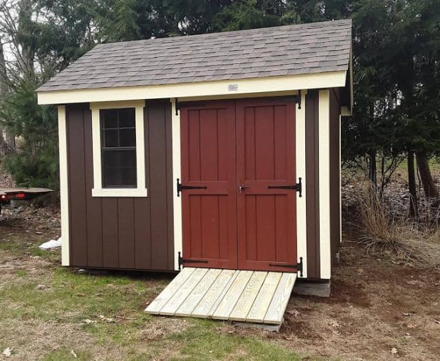 A-Frame Backyard Shed with Brown T-111 Siding, Red Double Door, and Cream Trim