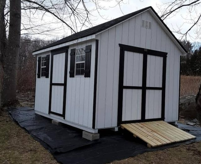A-Frame Backyard Shed with White T-111 Siding, Black Trim, and Black Shutters